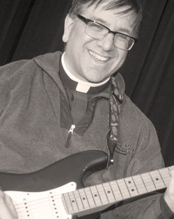 What other Improv Troupe has an electric guitar playing Catholic Priest? And he shreds, too.